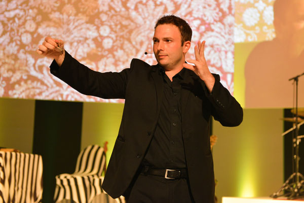 Larry Soffer using mentalism on stage