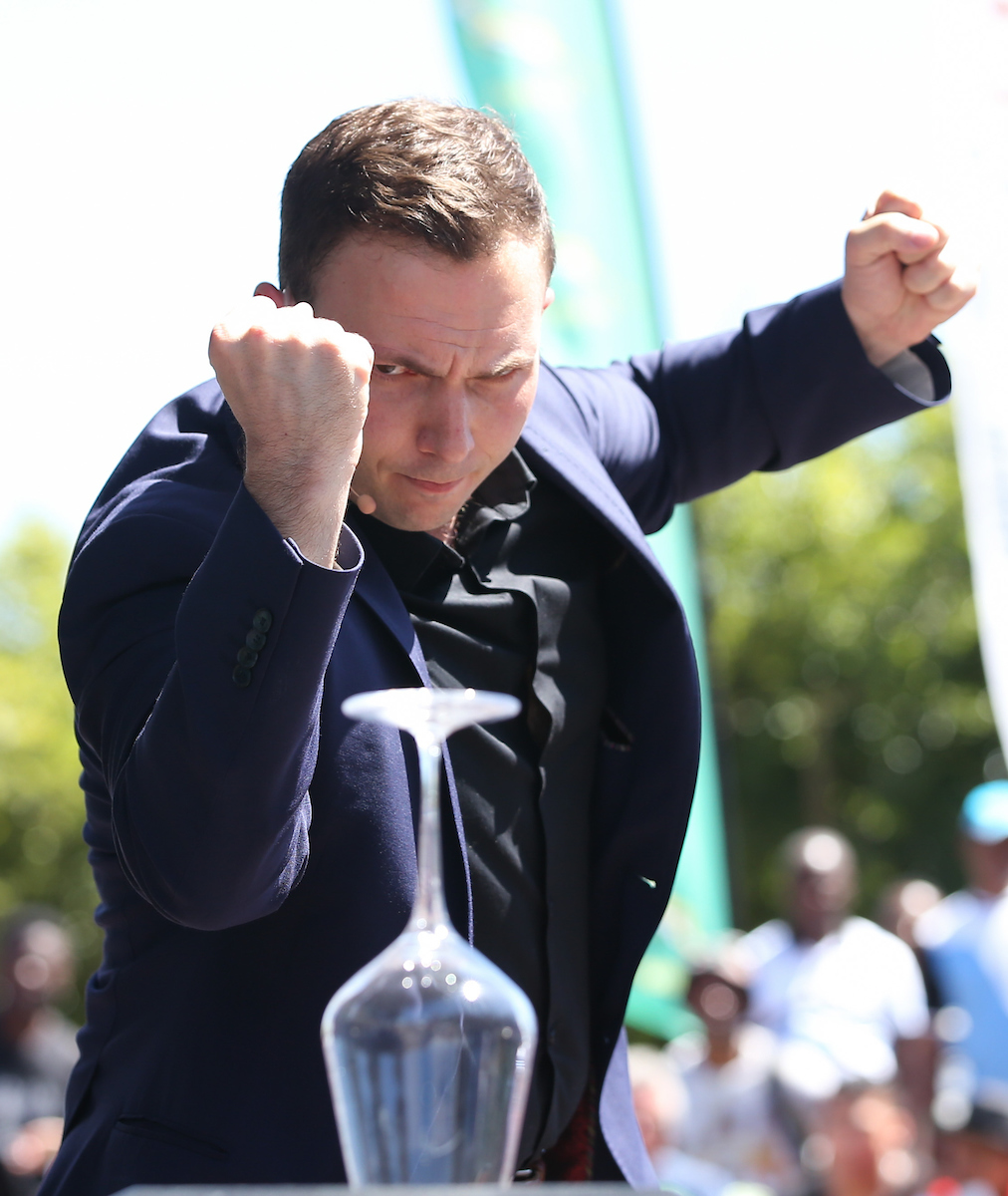 CAPE TOWN, SOUTH AFRICA - 7 December 2016, Larry Soffer performs his magic tricks during the Springbok 7's signing session at the V&A Waterfront ahead of the HSBC Cape Town 7's rugby tournament taking place at Cape Town Stadium on 10-11 December 2016.  (Photo by Roger Sedres/ImageSA)
